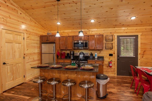 Breakfast bar for four in the kitchen at Paws on the Porch, a 2 bedroom cabin rental located in Gatlinburg