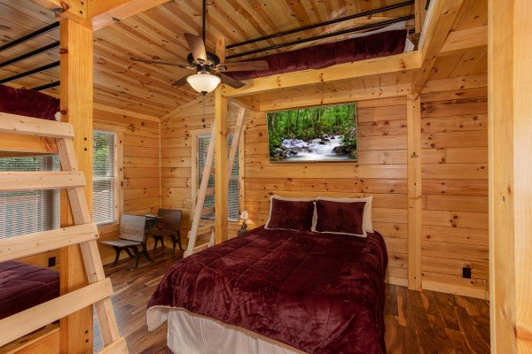 Bunk room with multiple beds at Paws on the Porch, a 2 bedroom cabin rental located in Gatlinburg