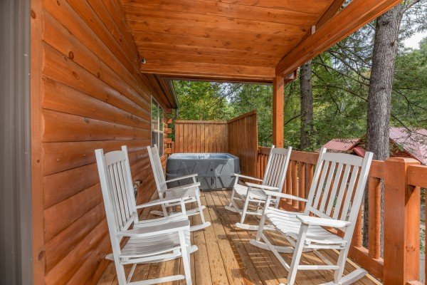Covered porch with rocking chairs at Paws on the Porch, a 2 bedroom rental cabin in Gatlinburg
