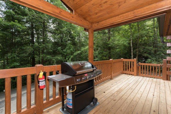 Propane grill on a covered deck at Paws on the Porch, a 2 bedroom cabin rental located in Gatlinburg
