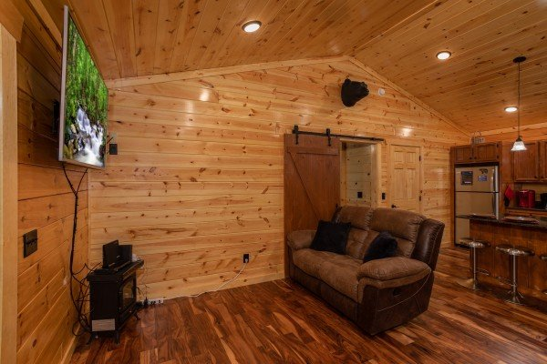 Living room and kitchen at Paws on the Porch, a 2 bedroom cabin rental located in Gatlinburg