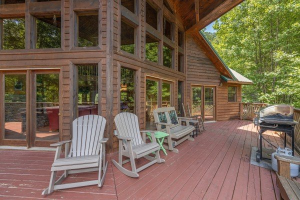 Deck rocking chairs, bench, and grill at Kaleidoscope, a 2 bedroom cabin rental located in Pigeon Forge