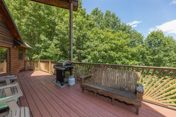 Bench and grill on a deck at Kaleidoscope, a 2 bedroom cabin rental located in Pigeon Forge