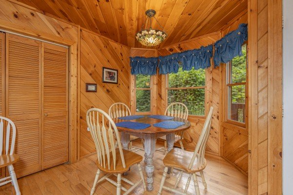 Dining table for four at Kaleidoscope, a 2 bedroom cabin rental located in Pigeon Forge