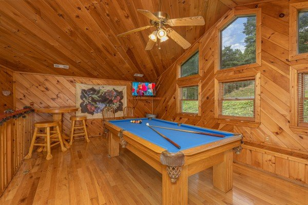 Pool table in the loft at Kaleidoscope, a 2 bedroom cabin rental located in Pigeon Forge