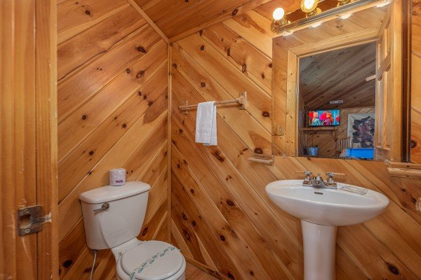 Half bath at Kaleidoscope, a 2 bedroom cabin rental located in Pigeon Forge