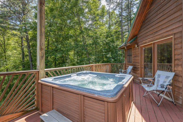 Hot tub on a deck at Kaleidoscope, a 2 bedroom cabin rental located in Pigeon Forge