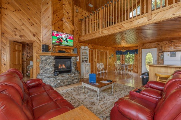 Fireplace and TV in the living room at Kaleidoscope, a 2 bedroom cabin rental located in Pigeon Forge