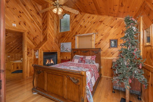 Bedroom with a fireplace at Kaleidoscope, a 2 bedroom cabin rental located in Pigeon Forge