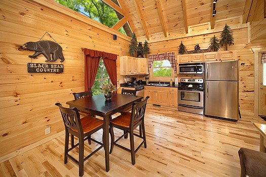 Dining table for four at Big Bear Cub House, a 1-bedroom cabin rental located in Gatlinburg