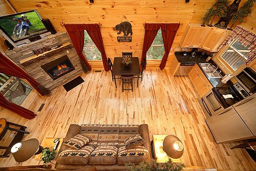 View of the living room from the lofted bedroom at Big Bear Cub House, a 1-bedroom rental located in Gatlinburg