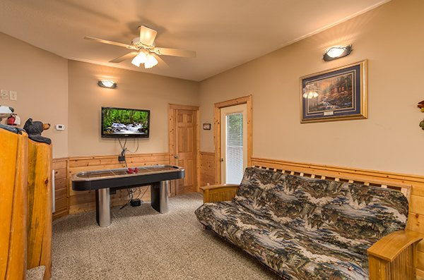 Air hockey table and a futon at At Home in the Woods, a 3-bedroom cabin rental located in Pigeon Forge