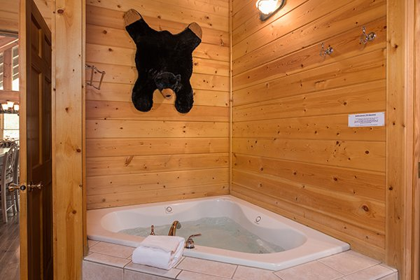 Corner jacuzzi tub at At Home in the Woods, a 3-bedroom cabin rental located in Pigeon Forge