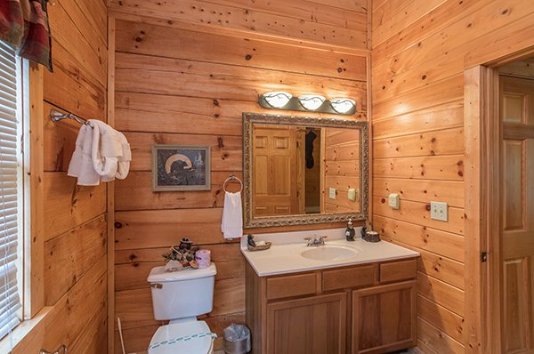 Bathroom at At Home in the Woods, a 3-bedroom cabin rental located in Pigeon Forge