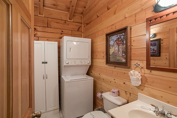 Stacked washer and dryer in a bathroom at At Home in the Woods, a 3-bedroom cabin rental located in Pigeon Forge