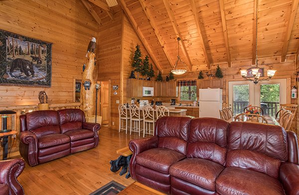 Leather couch and loveseat in the living room at At Home in the Woods, a 3-bedroom cabin rental located in Pigeon Forge