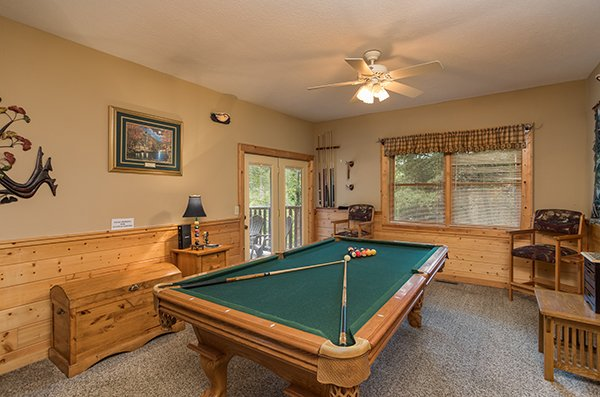 Pool table at At Home in the Woods, a 3-bedroom cabin rental located in Pigeon Forge