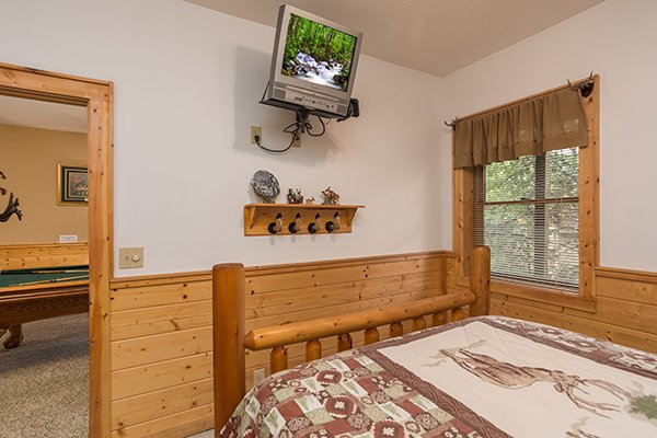 Second bedroom with a wall-mounted television at At Home in the Woods, a 3-bedroom cabin rental located in Pigeon Forge