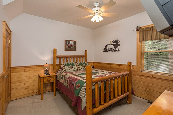 Bedroom with a log bed at At Home in the Woods, a 3-bedroom cabin rental located in Pigeon Forge