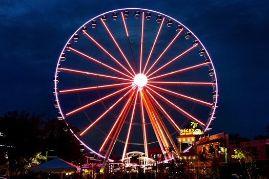 The Island ferris wheel at night at At Home in the Woods, a 3-bedroom cabin rental located in Pigeon Forge