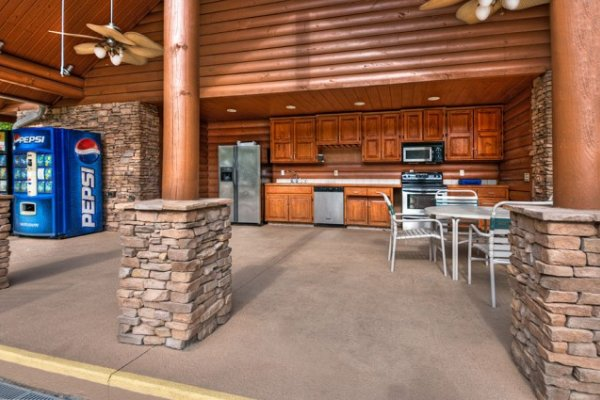Outdoor kitchen clubhouse at the pool area at Hidden Hideaway, a 3-bedroom cabin rental located in Pigeon Forge