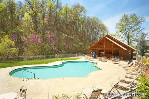 Guests at Hidden Hideaway, a 3-bedroom cabin rental located in Pigeon Forge have access to the pool at Alpine Mountain Village