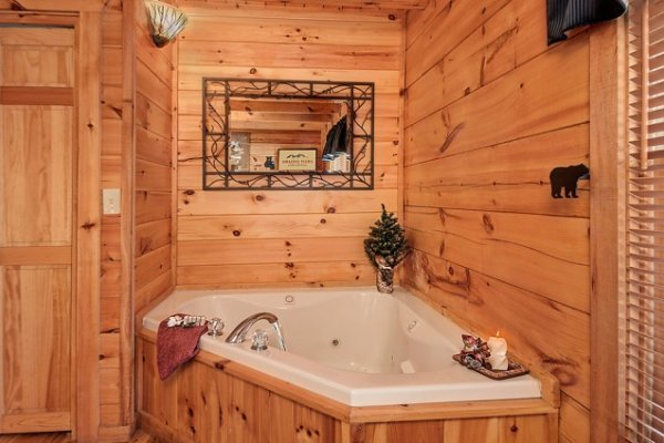 Jacuzzi tub in a corner of a bedroom at Hidden Hideaway, a 3-bedroom cabin rental located in Pigeon Forge