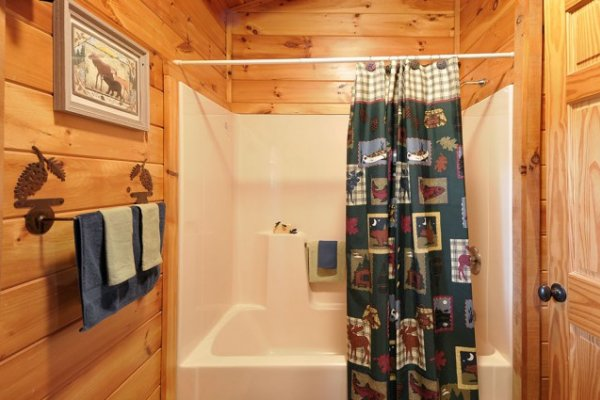 Bathroom with a tub and shower at Hidden Hideaway, a 3-bedroom cabin rental located in Pigeon Forge