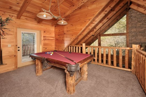 Pool table in the loft at Hidden Hideaway, a 3-bedroom cabin rental located in Pigeon Forge