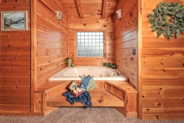 In room jacuzzi at Hidden Hideaway, a 3-bedroom cabin rental located in Pigeon Forge