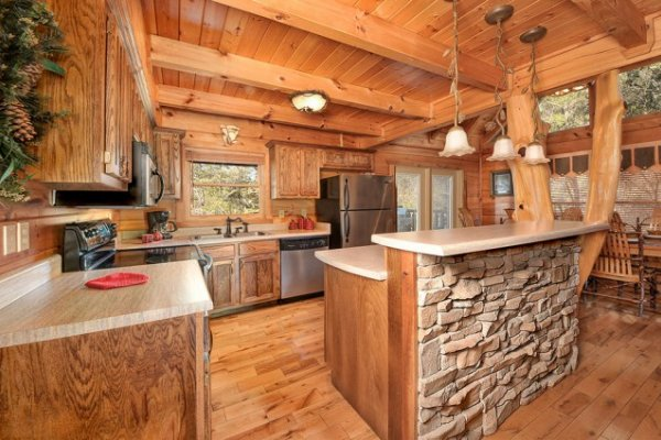 Custom kitchen with stainless appliances and an island at Hidden Hideaway, a 3-bedroom cabin rental located in Pigeon Forge