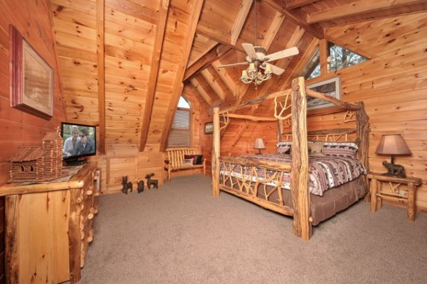 King log canopy bed in the loft space at Hidden Hideaway, a 3-bedroom cabin rental located in Pigeon Forge