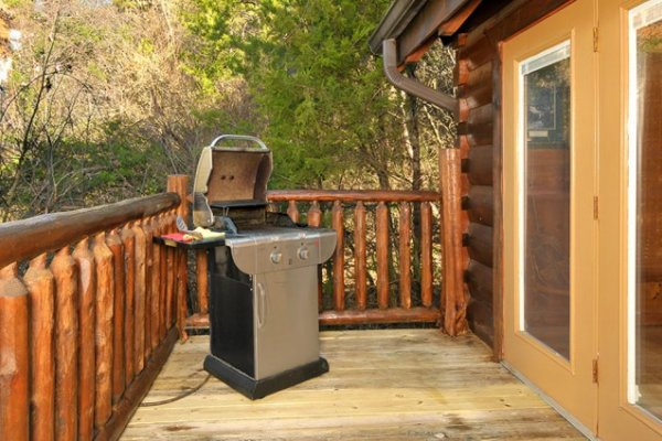 Propane grill on the deck at Hidden Hideaway, a 3-bedroom cabin rental located in Pigeon Forge