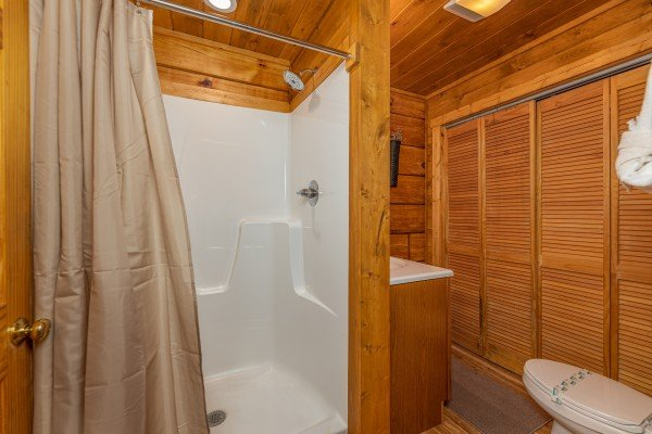 Bathroom with a large shower at Honeymoon in Gatlinburg, a 1 bedroom cabin rental located in Gatlinburg
