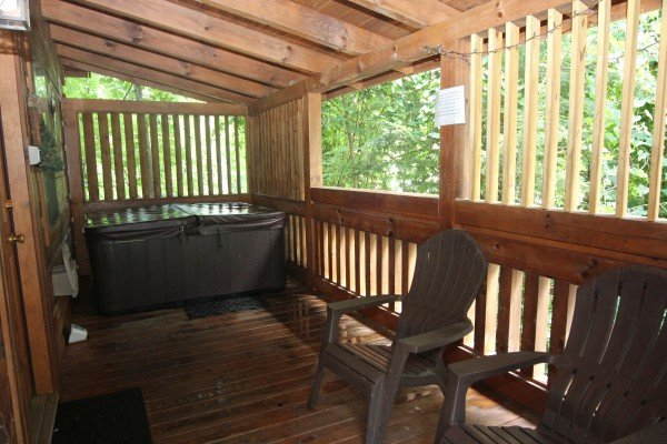 Hot tub on a deck with privacy fencing at Honeymoon in Gatlinburg, a 1 bedroom cabin rental located in Gatlinburg