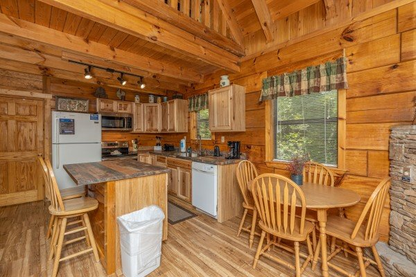 Kitchen and dining space at Honeymoon in Gatlinburg, a 1 bedroom cabin rental located in Gatlinburg