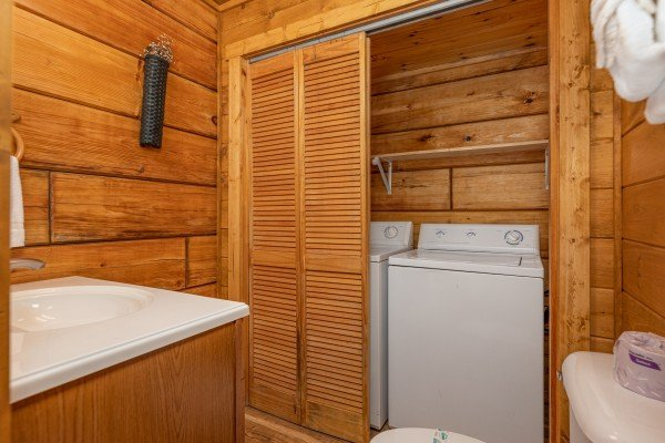 Washer and dryer in a bathroom at Honeymoon in Gatlinburg, a 1 bedroom cabin rental located in Gatlinburg