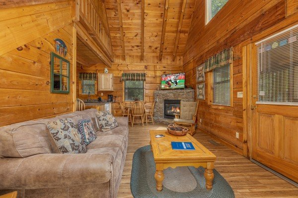 Living room with TV and fireplace at Honeymoon in Gatlinburg, a 1 bedroom cabin rental located in Gatlinburg