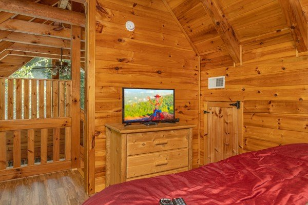 Bedroom with a dresser and TV at Honeymoon in Gatlinburg, a 1 bedroom cabin rental located in Gatlinburg