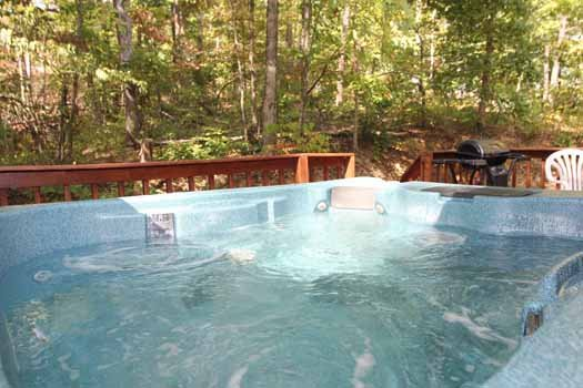 deck with hot tub and grill at splendid isolation a 1 bedroom cabin rental located in pigeon forge