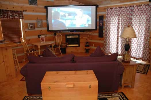 view from the bedroom of the living room at a point of view a 1 bedroom cabin rental located in pigeon forge