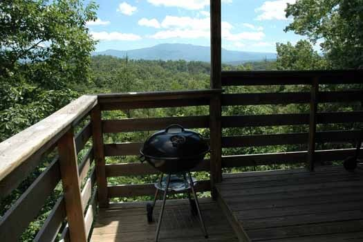 cook something delicious on the charcoal grill at a point of view a 1 bedroom cabin rental located in pigeon forge