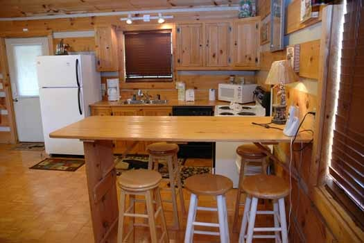 kitchen with barstools at a point of view a 1 bedroom cabin rental located in pigeon forge