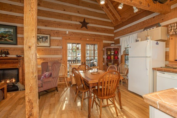 Dining space for four in the kitchen at Sassafras Lodge, a 3 bedroom cabin rental located in Gatlinburg
