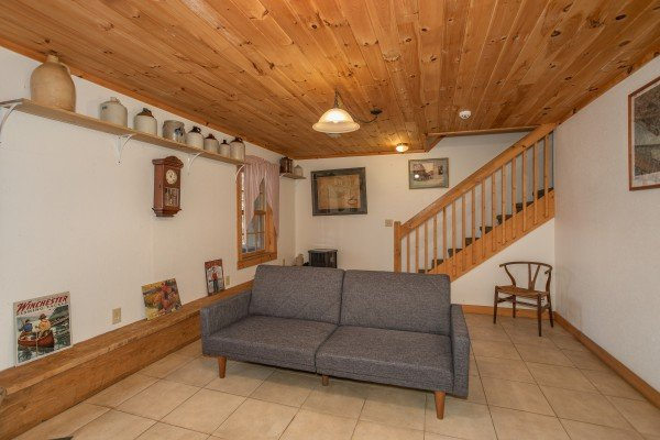 Sofa in the lower living room at Sassafras Lodge, a 3 bedroom cabin rental located in Gatlinburg