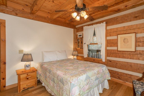 Bedroom on the main floor at Sassafras Lodge, a 3 bedroom cabin rental located in Gatlinburg