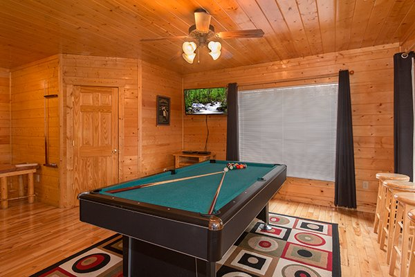 Green felted pool table in the game room at Country Bear's Getaway, a 3-bedroom cabin rental located in Gatlinburg