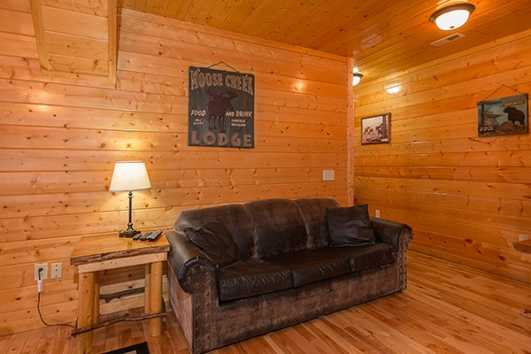 Sleeper sofa in the game room at Country Bear's Getaway, a 3-bedroom cabin rental located in Gatlinburg