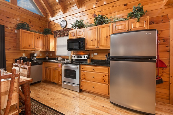 Kitchen with stainless steel appliances at Country Bear's Getaway, a 3-bedroom cabin rental located in Gatlinburg