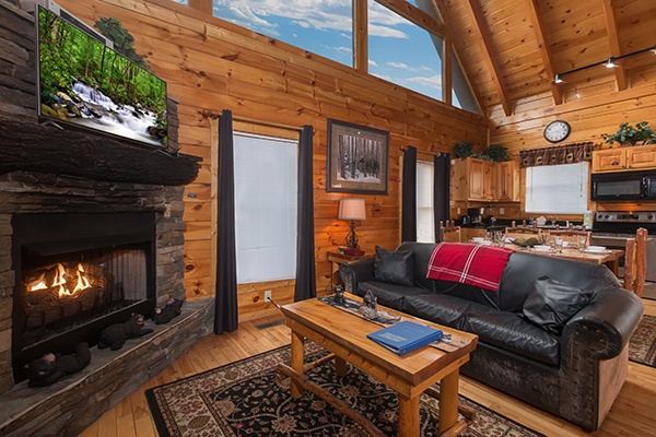 Living room with fireplace, TV, and lots of natural light Country Bear's Getaway, a 3-bedroom cabin rental located in Gatlinburg
